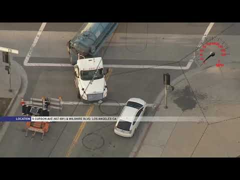 Police chase stolen tanker truck carrying 2,000 gallons of unknown liquid in Mid-Wilshire area of LA