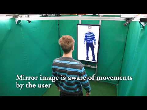 A Free-Viewpoint Virtual Mirror with Marker-Less User Interaction