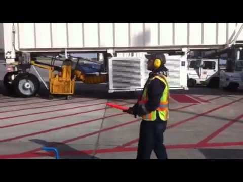 Porter Airlines Ramp Agent Marshalling Aircraft YUL - YouTube