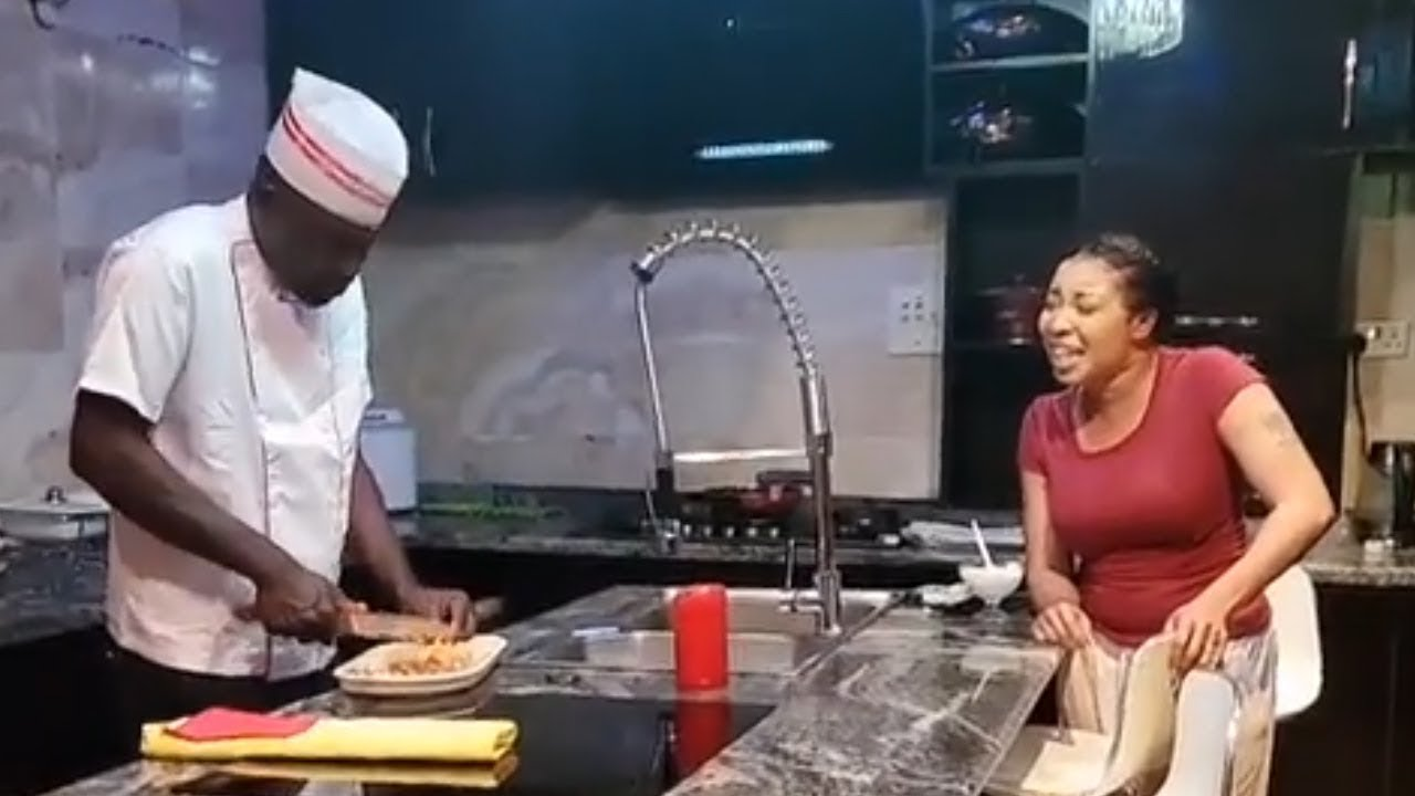 LIZZY ANJORIN AND HUSBAND HAVING A NICE TIME IN THE KITCHEN AS MR LAWAL PREPARE MEAL FOR THE FAMILY