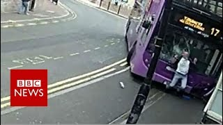 CCTV footage shows man hit by bus in Reading - BBC News