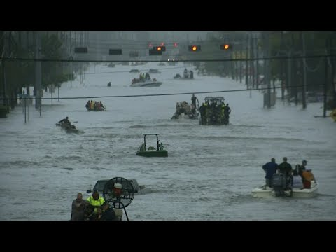 Rescue Boats Fill Flooded Roads in Texas