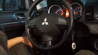 Снятие руля MITSUBISHI LANCER X. Замена датчика угла поворота рулевого колеса.
