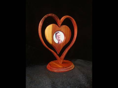 Make a heart-in-a-heart picture frame with wood. Awww...it\'s cute ...