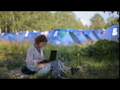 Russia, Siberia 2014: Woman on nature with a laptop. Tourist with laptop