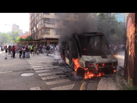 Bus burned in another day of Caracas protests
