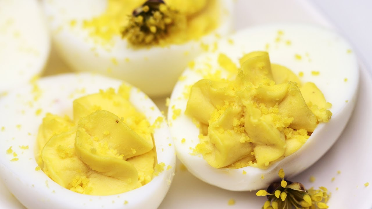 Gently peel the hard-boiled eggs and cut in half lengthwise. Scoop out the yolks and place in a small bowl. Rinse the whites in water and place hole­-side-down on a paper towel to dry.