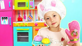 Cooking breakfast for mommy with kitchen toys