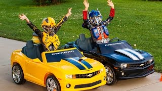 Transformers Power Wheels Race - Bumblebee vs Optimus Prime!
