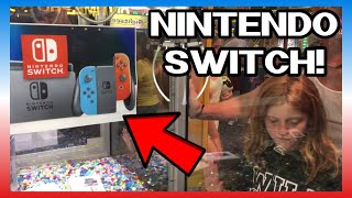 NINTENDO SWITCH CLAW MACHINE ON THE BOARDWALK! CAN WE WIN IT?? $10 CHALLENGE