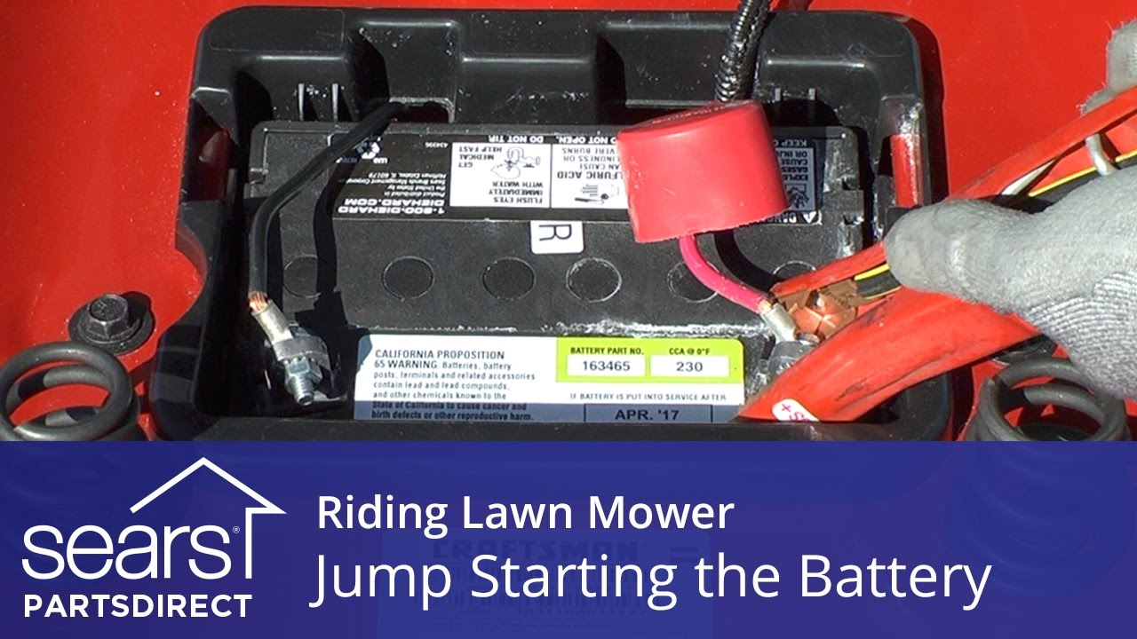 jump starting a riding lawn mower [ 1280 x 720 Pixel ]