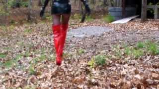 Red boots microskirt in forest