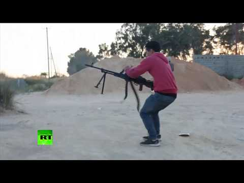 On the frontline: Bullets fly as battle for Tripoli continue