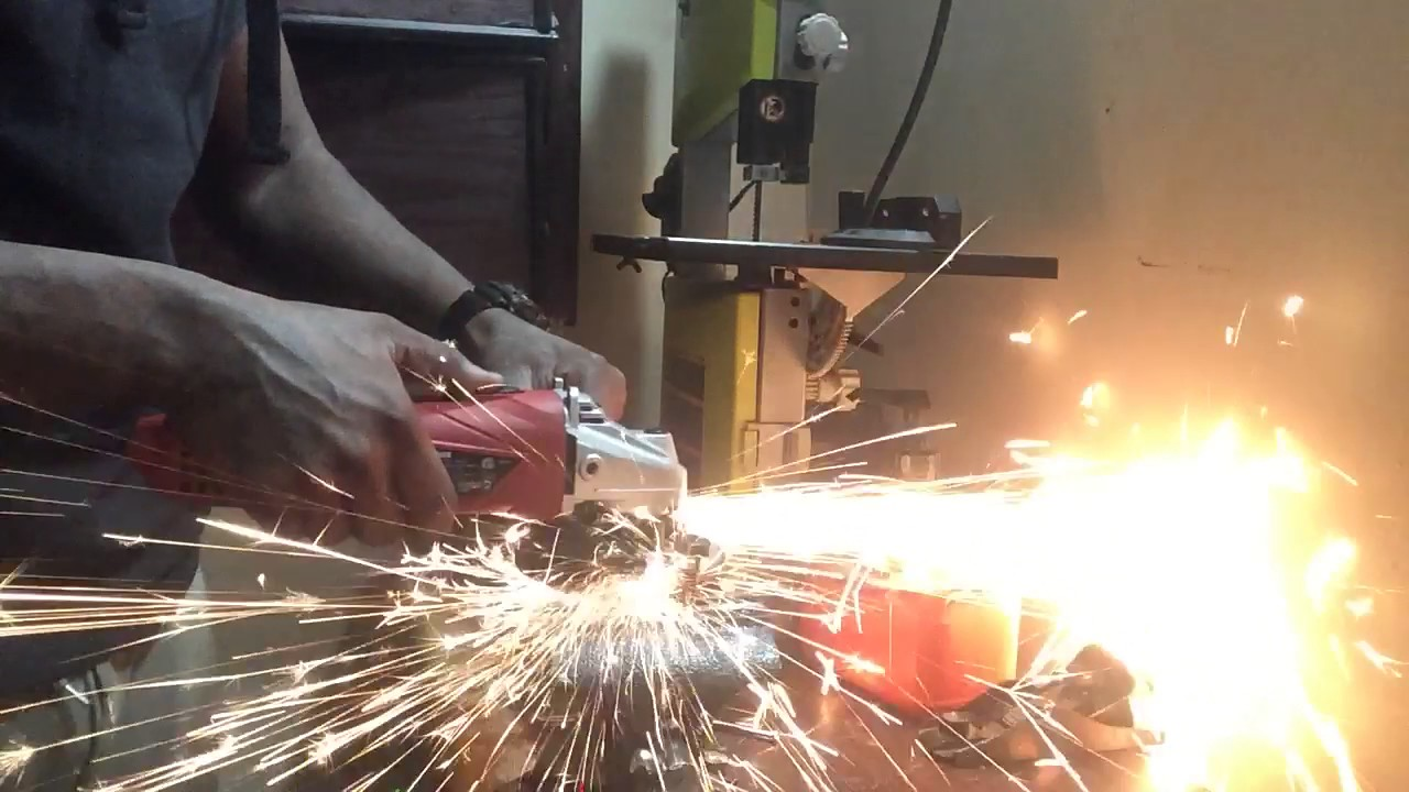 Hyper Tough angle grinder cutting a grade 8 bolt