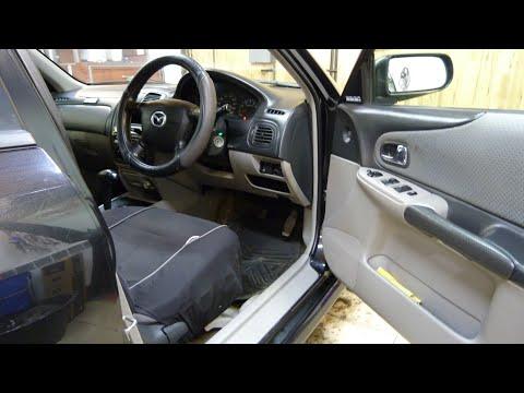 Тонировка, Замена магнитолы Mazda Familia 2001