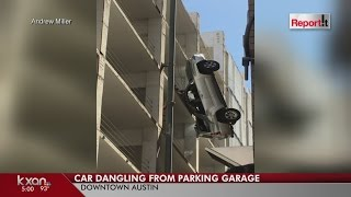 SUV dangles from downtown Austin parking garage after driver drives off the top floor