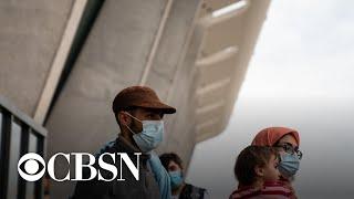 U.S.-bound Afghan evacuation flights temporarily halted over measles concern