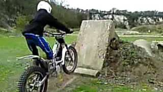 tom coy sherco trials up concrete slab. slo-motion