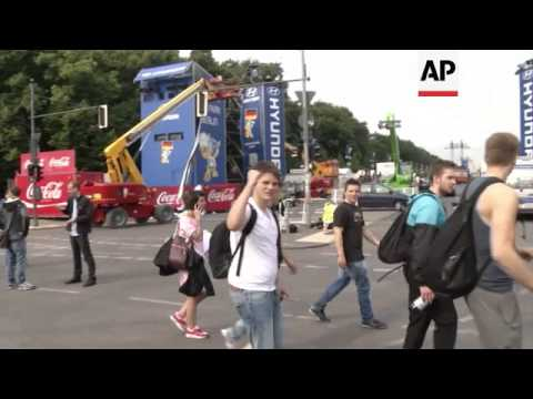 Morning scenes in Berlin after Germany wins the football World Cup; preparations for return of team