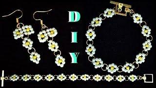 Kids craft.  Beads jewelry making. Beaded bracelet. Beaded earrings
