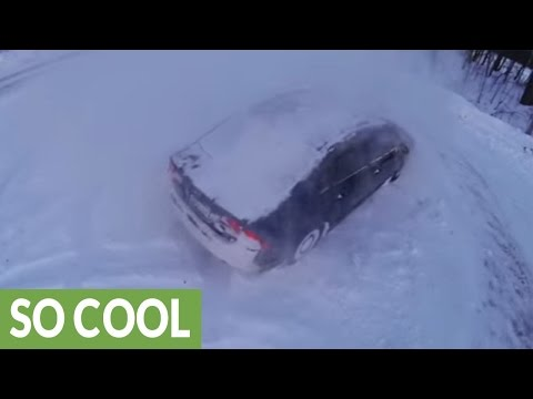 Epic Honda snow drifting filmed with drone