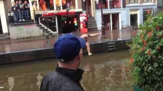 Guy jumps in canal -  The red light district Amsterdam - The black tiger Bar
