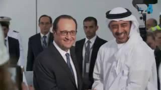 عبدالله بن زايد وهولاند في موقع اللوفر في أبوظبي