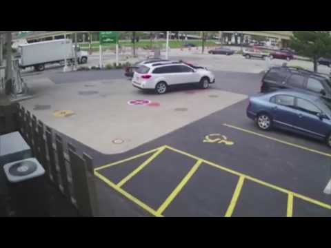 Video: Woman jumps on car to stop thieves at Milwaukee gas station