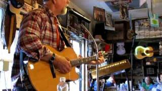 "LIVE AT THE COOK SHACK - JOHN McCUTCHEON - ""The Red Corvette"""