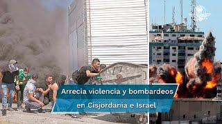 Arrecia la violencia en Cisjordania y bombardeos de ambos lados, mientras destruyen sede de medios; Biden intenta mediar