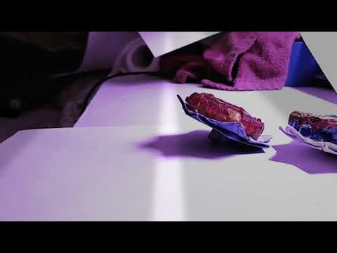 How to make a paper beyblade with a real burst top. Plus a tip