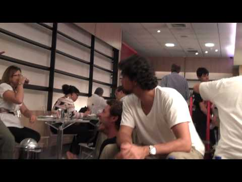 Philippoussis explains his dogwalking skills to Safin, Courier and Pioline in the Rio airport lounge