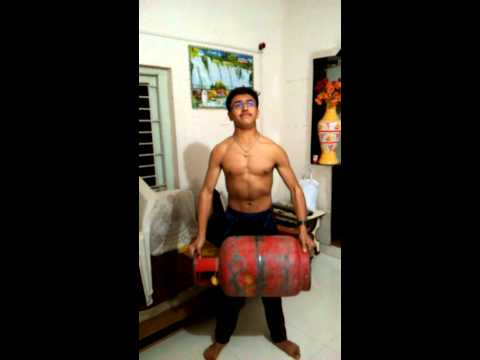 Weight lifting with empty gas cylinder (15.3 Kg.)