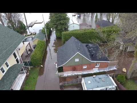 Montreal historical flooding of Spring 2017. Submerged island, bridge, boats on the street. Aerial