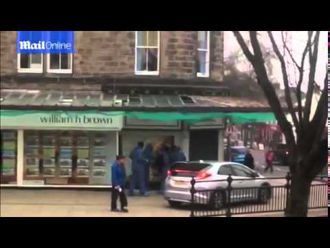 Dramatic Footage Of Axe Wielding Raiders Daytime Smash and Grab