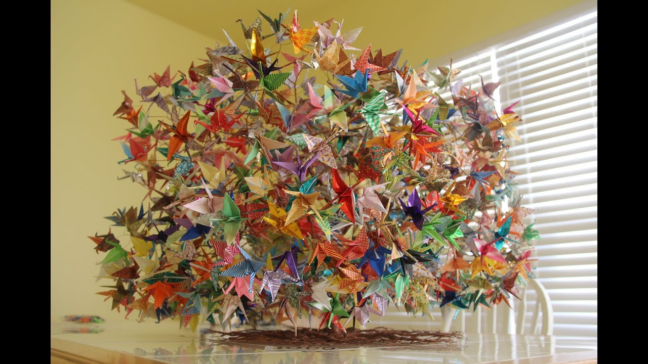 Construction of 1000 origami folding paper cranes on a wired tree  YouTube