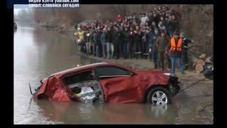 В Славянске-на-Кубани со дна реки достали внедорожник с телами двух человек.