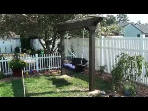 Pergola / Arbor garden swing - wicker & wood