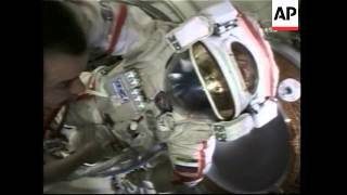Russian cosmonaut hits golf ball from ISS in stunt