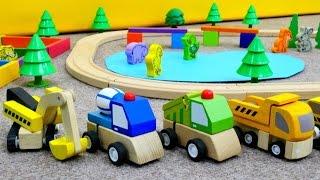 Spielzeugautos bauen einen Tierpark. Trickfilm für Kleinkinder.