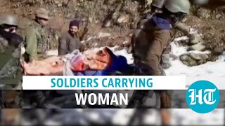 Watch: In J&K, Army soldiers carry new mother on stretcher on snow-covered road
