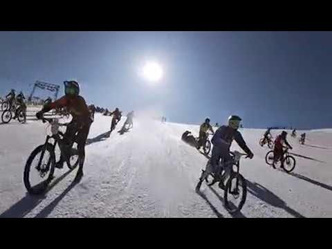 Man Dodges Hundreds of Bikers on Snowy Mountain || ViralHog