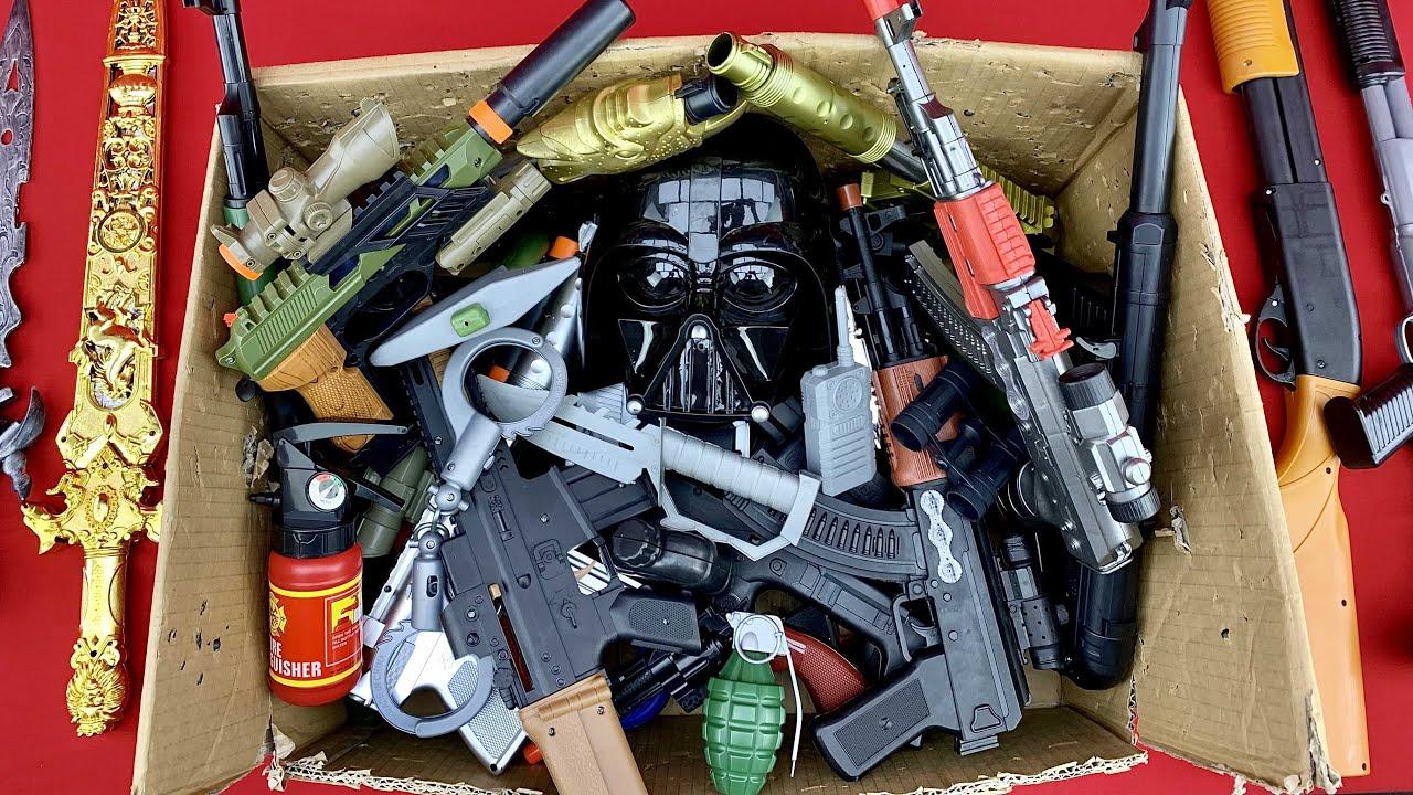 Box of Weapons, BB Guns, Equioments, Mask Toys - Gladiator Swords, Cowboy Shotguns and more.
