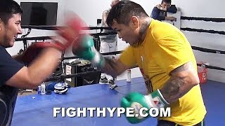 MAIDANA GOING HARD AS HE FIRES OFF COMBINATIONS SPEED INCREASING AS HE SLIMS DOWN