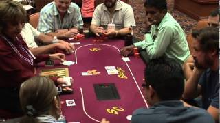 Poker Game Texas Holdem Las Vegas Casino Video of Dealer dealing Cards to Players round a Card Table