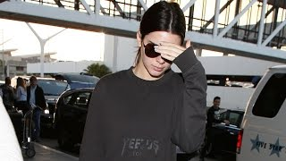 EXCLUSIVE - Kendall Jenner Wears No Makeup And Yeezus Shirt At LAX