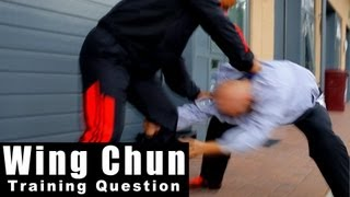 Wing Chun training questions - how to deal with suprise attack from behind Q35