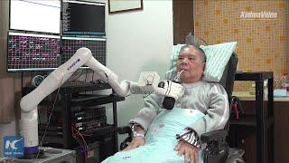 Elderly Chinese man mind-controls robotic arm in Zhejiang, China