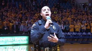 watch this cop perform national anthem after singer got stuck in traffic