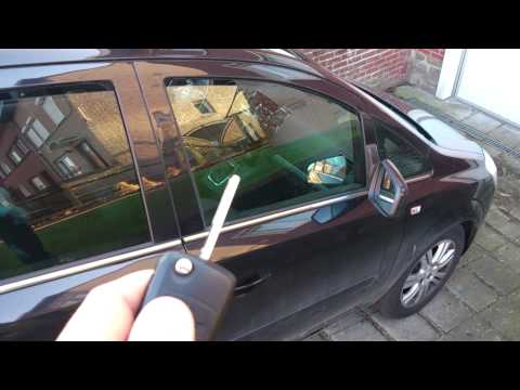 how to open mazda key to change battery